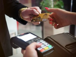 Ochopee Debt Reduction photo of person handing card 2988232 300x225